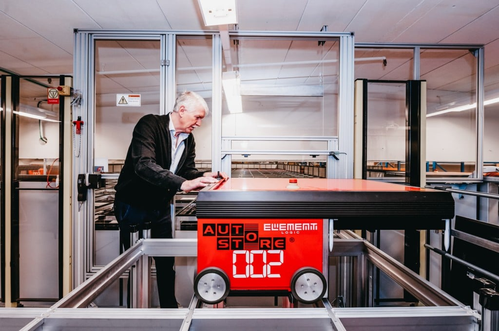 Jan Kleven is working on one of the AutoStore-robots.